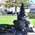 Statue of Pania side on with Marine Parade in the background.