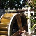 The Sunken Garden Waterwheel from the side close up.