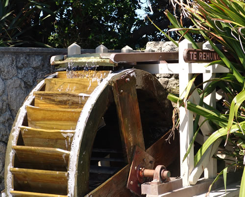 Amazing The Sunken Garden Waterwheel From The Side Close Up.
